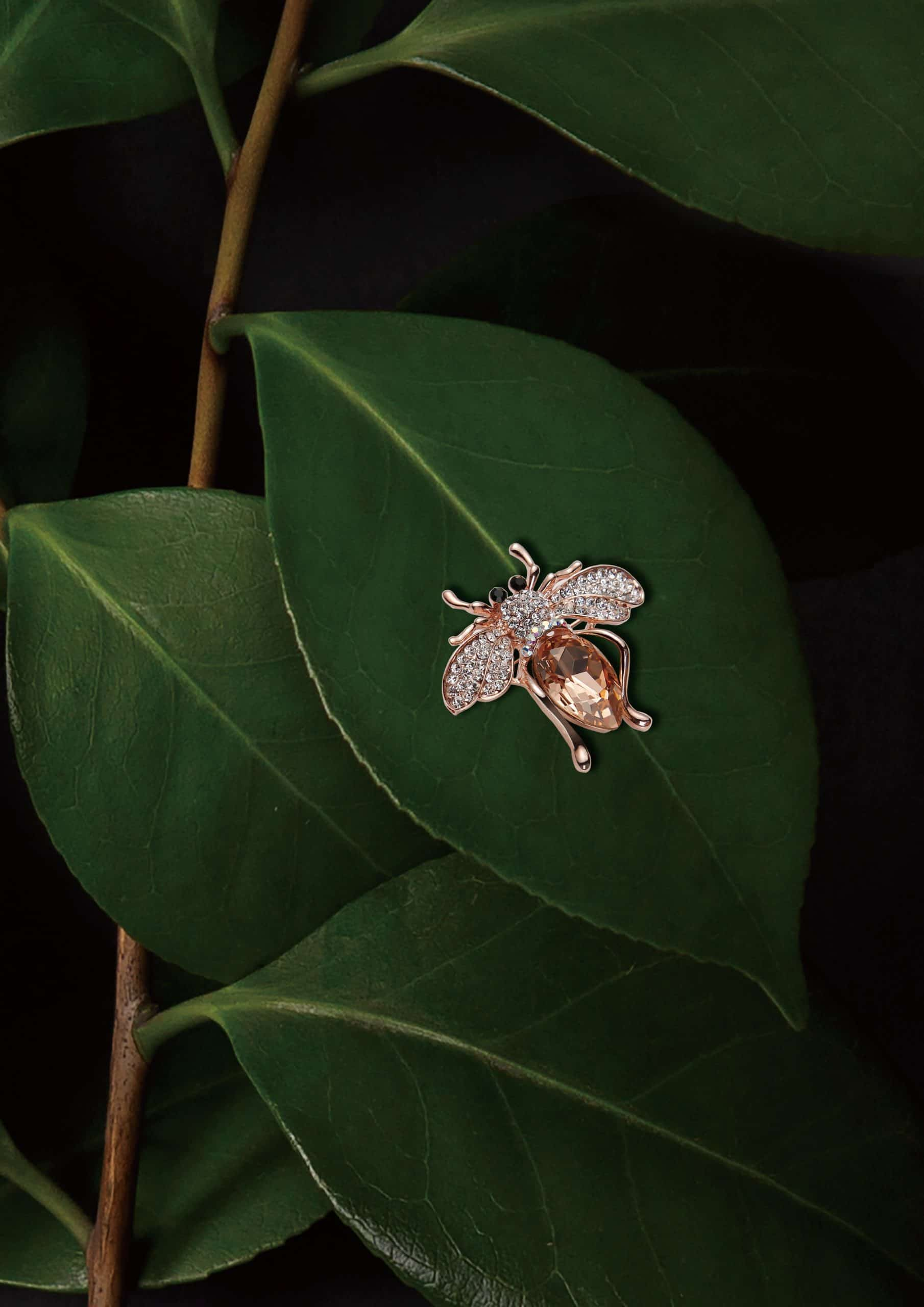insect pendant on green leaves
