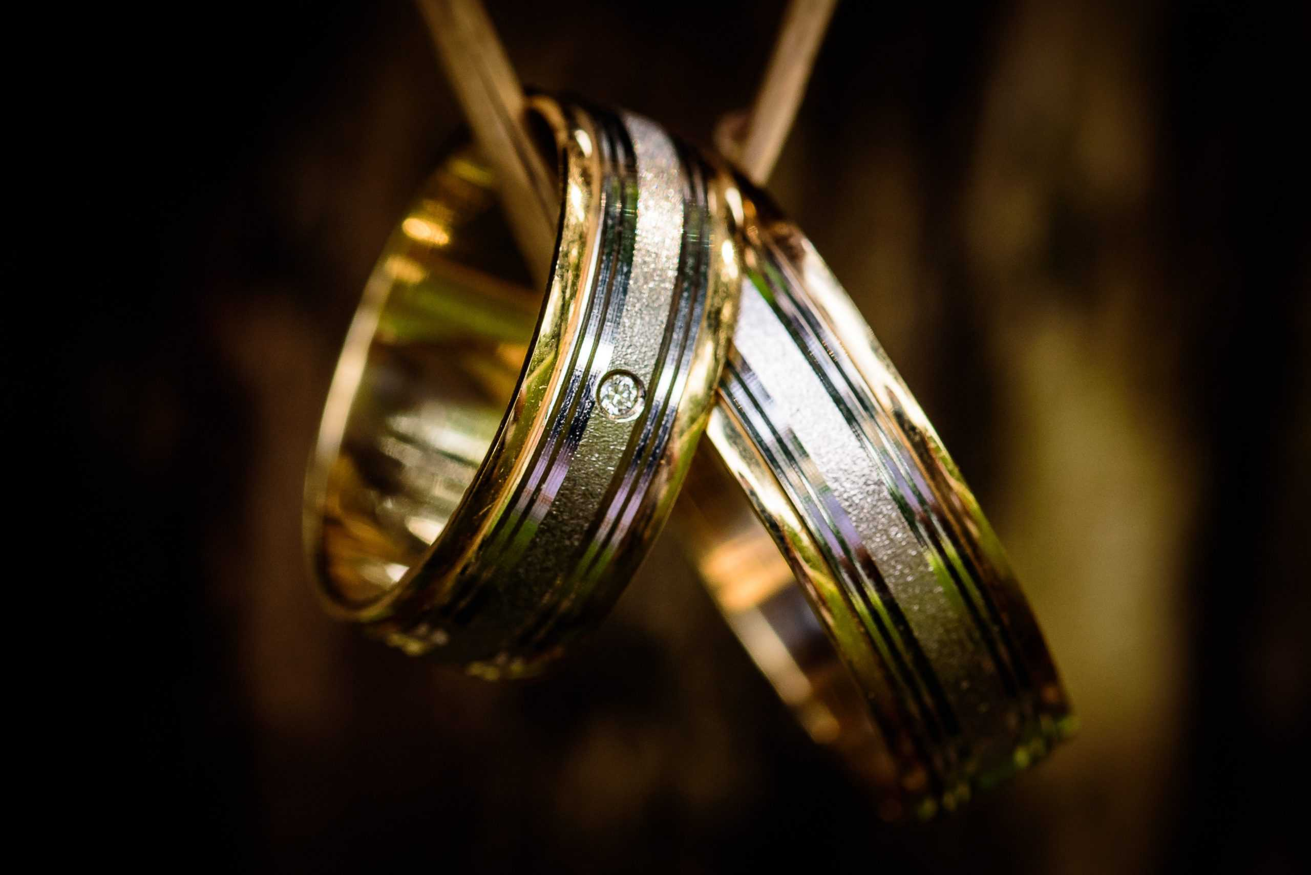 silver and gold rings on chain