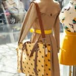 trench coat with yellow tote