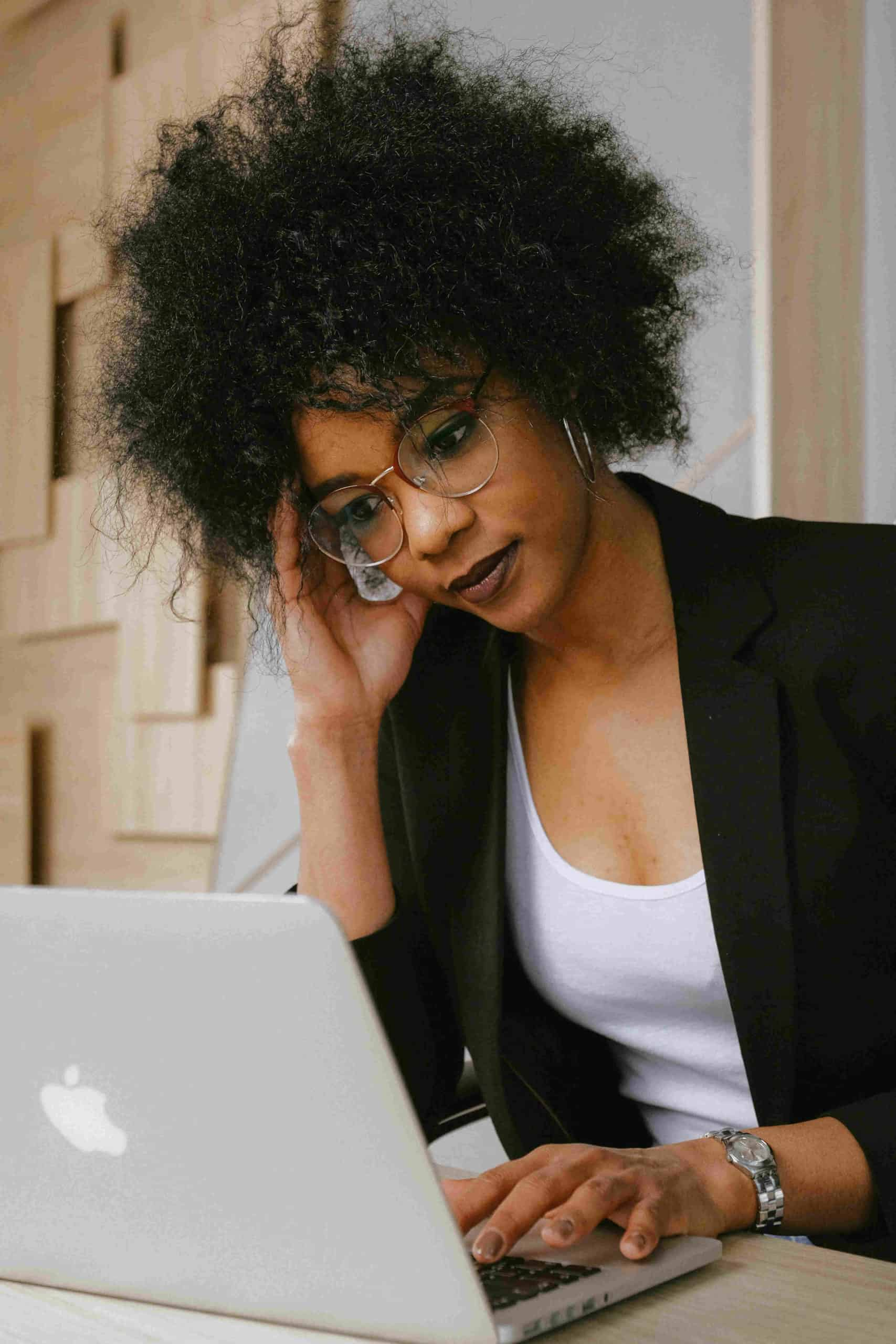lady with afro working on laptop